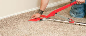 Carpet stretching with a power stretcher