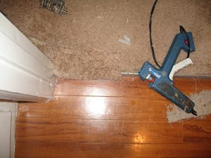 Carpet patch at transition with glue gun