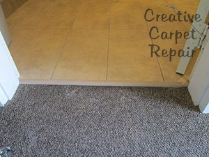 rather than stretching or patching the carpet the customer chose to have us install a rubber strip here i think it was a great choice